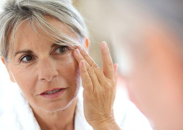Woman contemplating occuloplastics